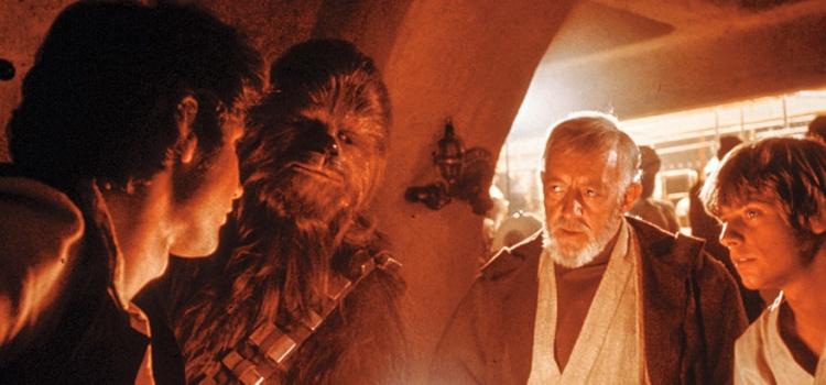 Star Wars (1977) Directed by George Lucas Shown from left: Harrison Ford (as Han Solo), Peter Mayhew (as Chewbacca), Alec Guinness (as Obi-Wan Kenobi), Mark Hamill (Luke Skywalker)